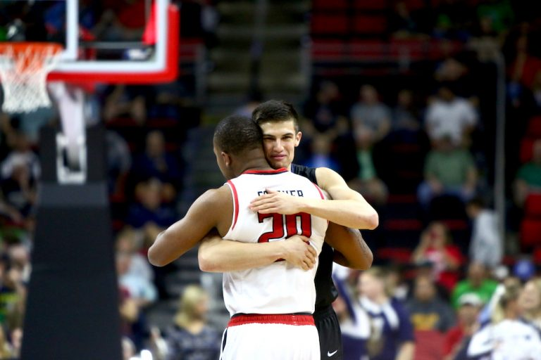 Kellen Dunham (24) and Toddrick Gotcher (20) embrace before the game. Butler defeats Texas Tech 71-61 during the First Round of the NCAA Tournament in Raleigh, NC on March 17, 2016.