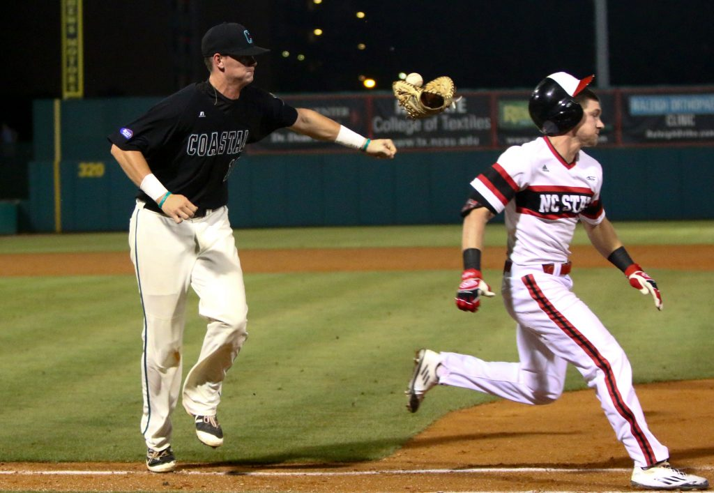 Kevin Woodall Jr. (19) loses his glove trying to tag Brock Deatherage (13). NC State hosted Coastal Carolina on the second day of the Raleigh Regional on June 4, 2016. (Photo by: Jerome Carpenter/WRAL contributor)