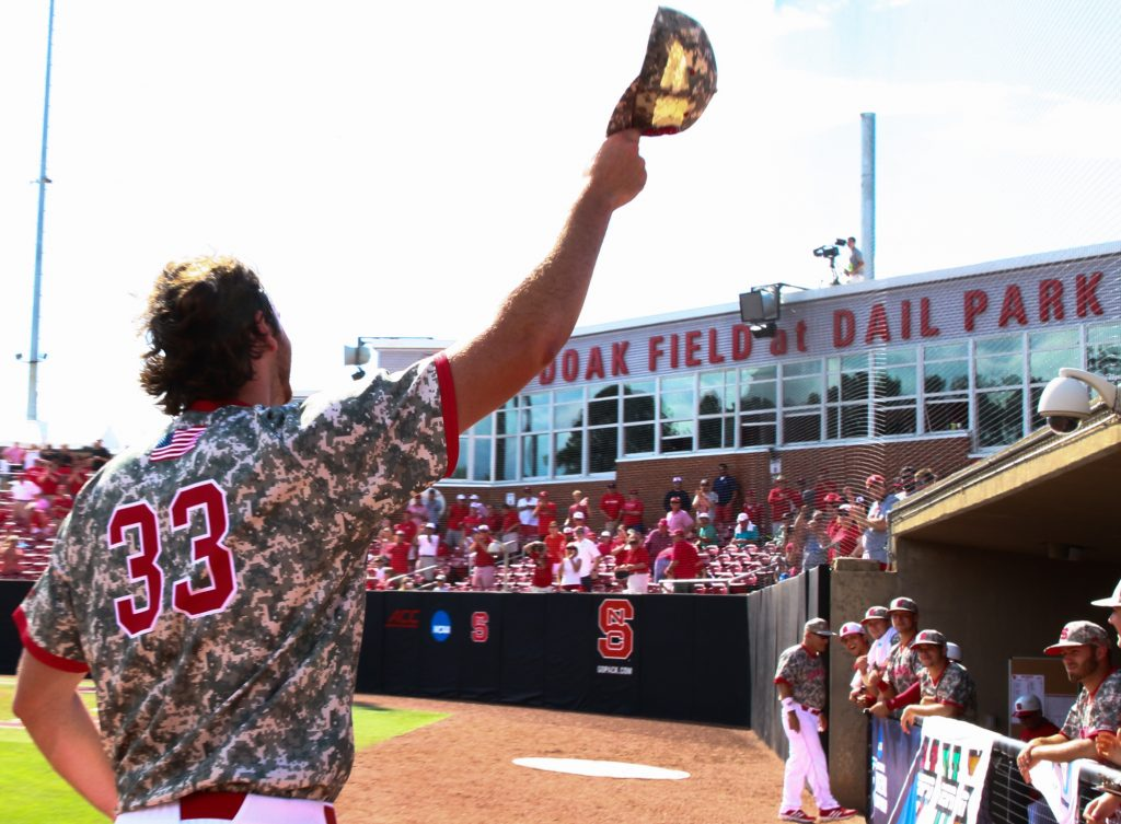 Johnny Piedmonte (33) comes back out to ti his cap to the fans. NC State routed Navy 17-1 to stay alive in the Raleigh Regional on June 5, 2016. (Photo by: Jerome Carpenter/WRAL contributor)