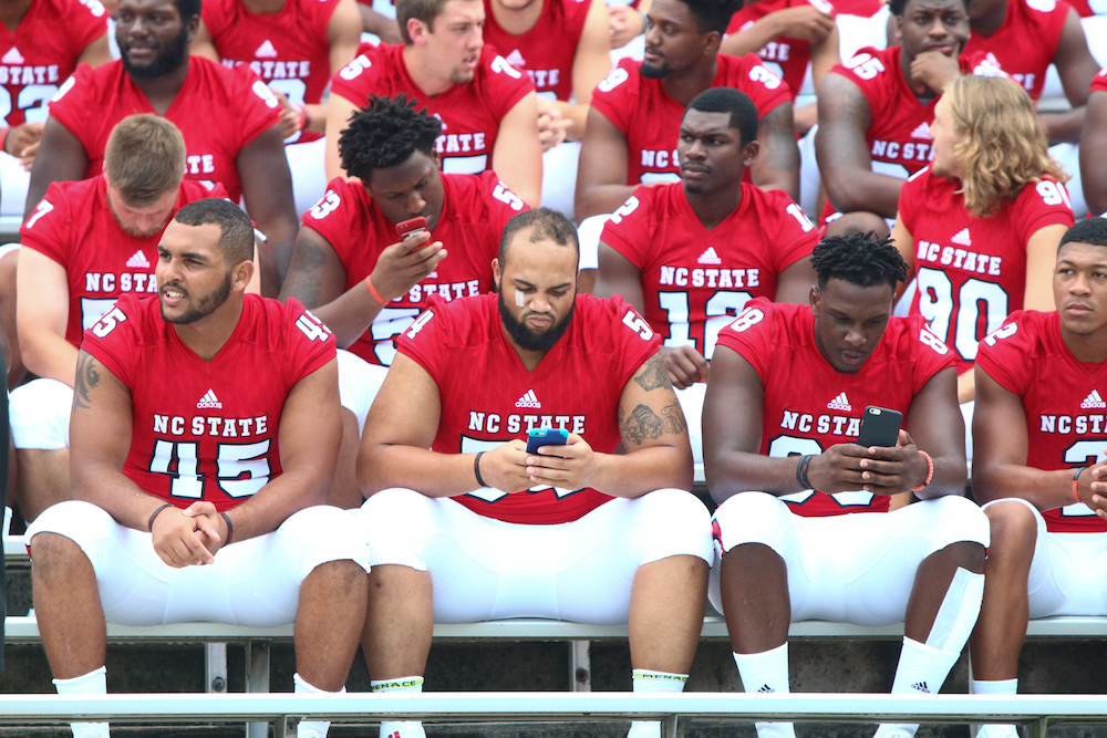Pack players wait to take their team photo. NC State Football hosted Meet the Pack at Carter-Finley Stadium in Raleigh, North Carolina on August 7, 2016. (Jerome Carpenter/WRAL Contributor)
