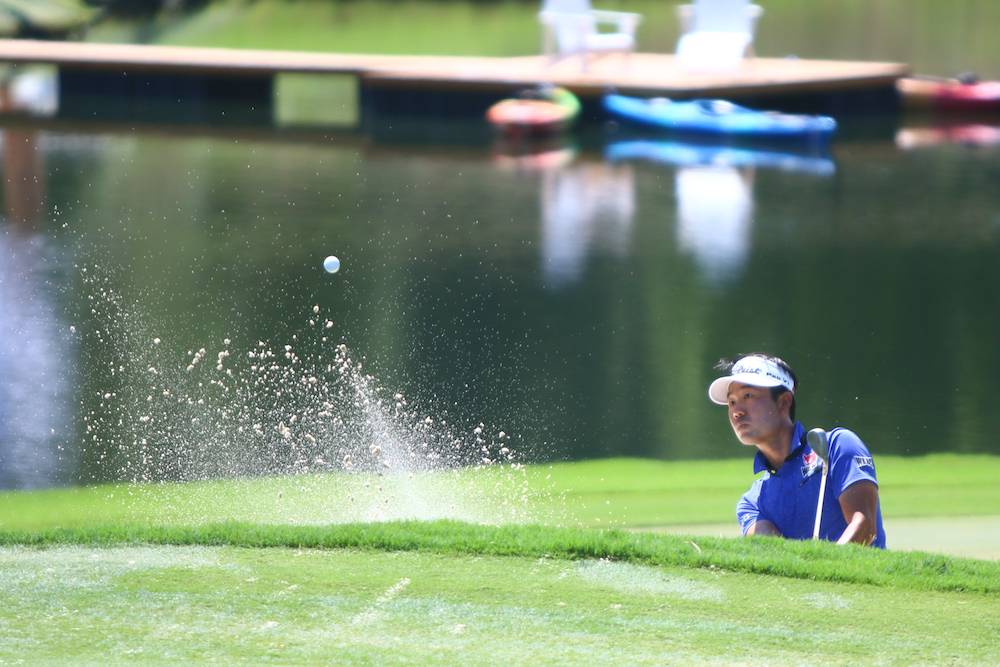 Kevin Na hits out of a bunker. Sedgefield Country Club hosted the 2016 Wyndham Championship on August 18, 2016 in Greensboro, North Carolina. (Jerome Carpenter/WRAL Contributor)