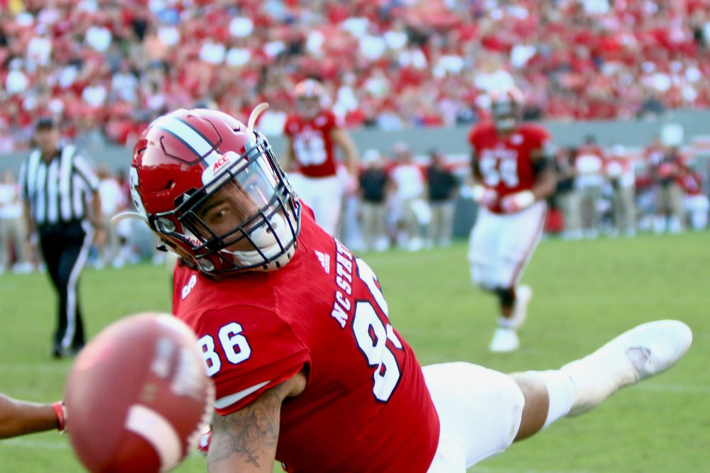 Thaddeus Moss (86) stretches for a ball just out of his reach. NC State defeated Wake Forest 33-16 on October 1, 2016 in Durham, North Carolina. (Jerome Carpenter/WRAL Contributor)