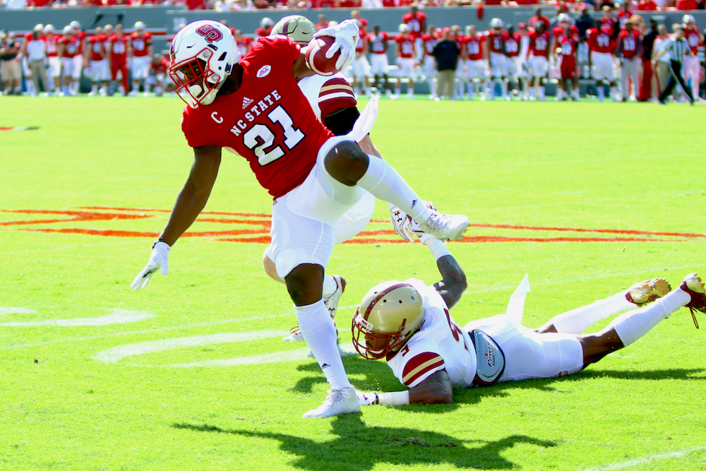 Matthew Dayes (21) steps around a tackler. Boston College defeated NC State 21-14 on October 29, 2016 at Carter-Finley Stadium in Raleigh, North Carolina. (Jerome Carpenter/WRAL Contributor)