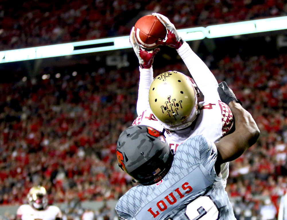 Tarvarus McFadden (4) goes up to grab an interception. Florida State defeated NC State 24-20 on November 5, 2016 at Carter-Finley Stadium in Raleigh, North Carolina. (Jerome Carpenter/WRAL Contributor)