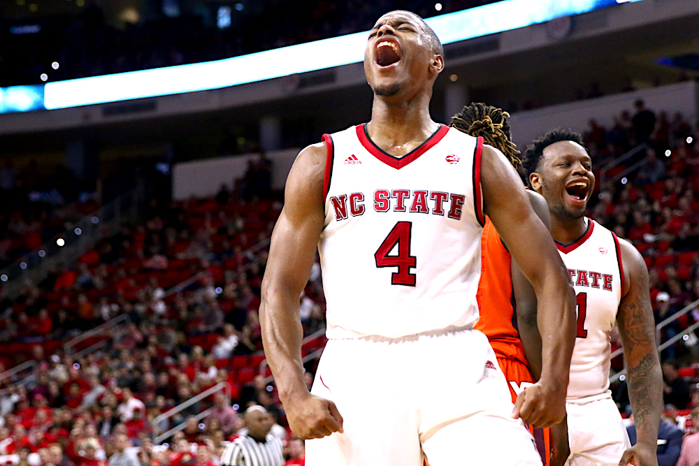 Dennis Smith Jr. (4) lets out a yell after a dunk. NC State defeated Virginia Tech 104-78 in their ACC home opener at the PNC Arena in Raleigh, NC on January 4th, 2017. (Photo by: Jerome Carpenter/WRAL Contributor)