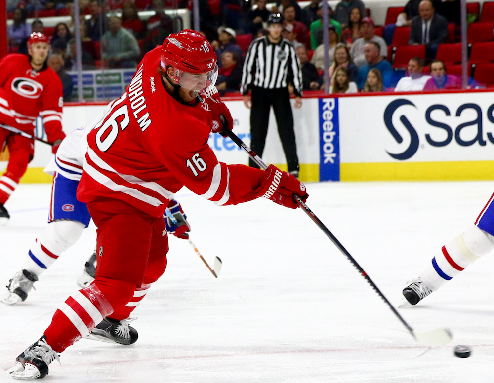 Elias Lindholm (16) rips off a shot. The Carolina Hurricanes defeated the Montreal Canadiens, by a score of 3-2, on November 18, 2016 in Raleigh, North Carolina. (Jerome Carpenter/WRAL Contributor)