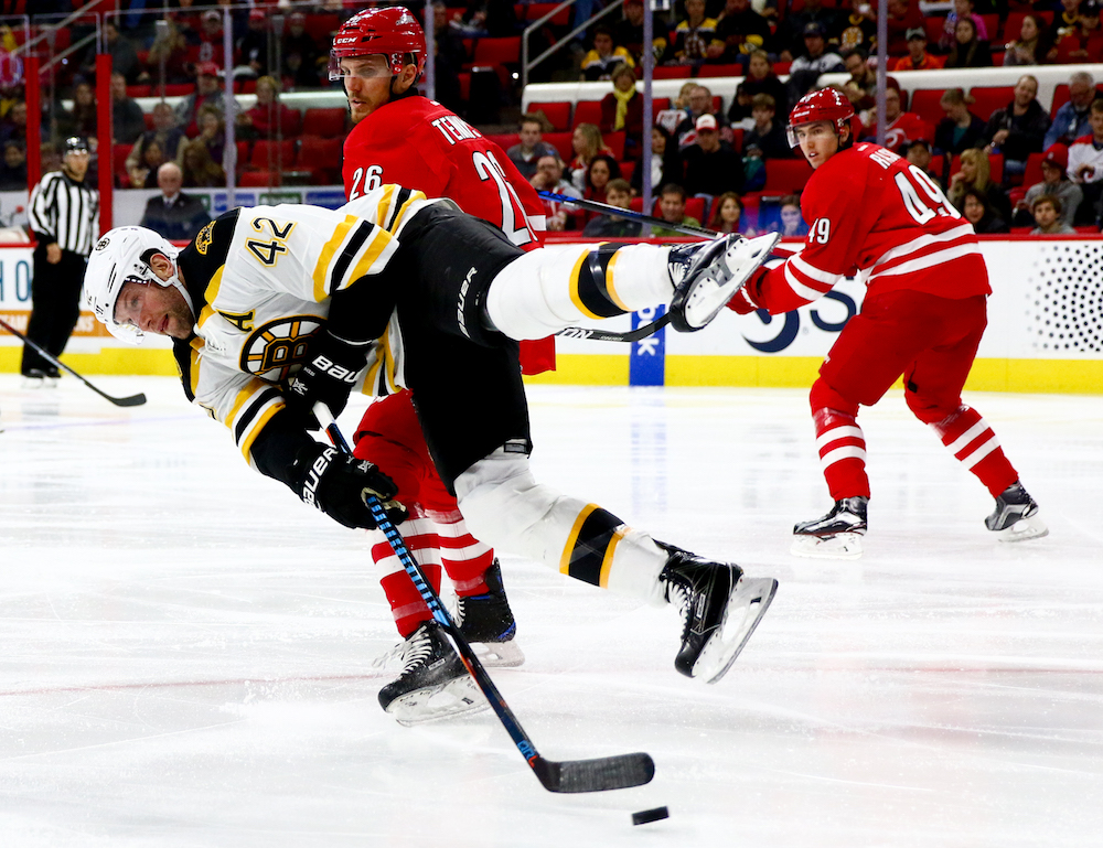David Backes (42) leaves his feet to get off a shot. The Carolina Hurricanes defeated the Boston Bruins in overtime, by a score of 3-2, on December 23, 2016 in Raleigh, North Carolina. (Jerome Carpenter/WRAL Contributor)